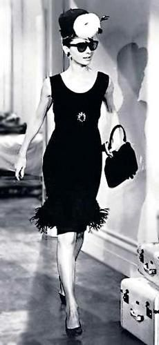 Audrey Hepburn wearing one of her famous black Givenchy dresses
