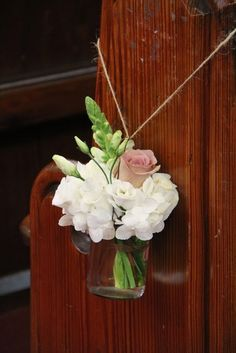 Posies of Antirhinnums, Hydrangeas, Lissianthus, Roses & Hydrangeas were placed in Jam Jars and hung from the pew ends lining the aisle