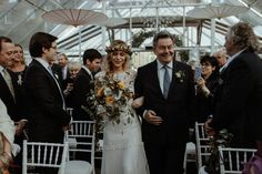 Bride walking down the aisle with her father at Clifton Nurseries - autumnal inspired wedding