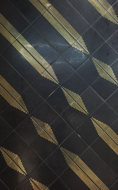 These beautiful marble tiles from Ann Sacks are sold with or without the brass inlay and patterns can be developed using the different patterns.