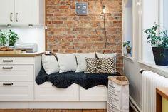 Un coin confortable dans la cuisine, idéal pour prendre le thé et consulter ses recettes !
