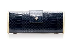 Tory Burch Snake roll clutch: 'Tis the season of the statement clutch — everyone should have at least one (or more) in her wardrobe.  #EditorsWishlist