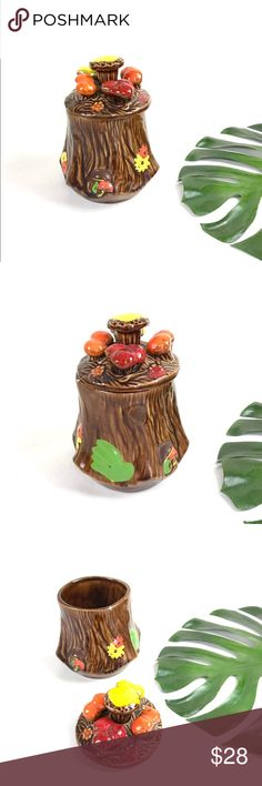 """Vintage 70s mushroom cookie jar ceramic canister kitschy cute 1970s cookie jar or canister for whatever you want to use it for!  DETAILS: +tree stump base +hand painted shrooms and toadstools  +adorable 3D lid +no markings  CONDITION: overall great vintage condition, a few chips in the paint + one on the top that you can't see when the lid is on  MEASUREMENTS (approximate): 7.5"""" x 9.5"""" Vintage Other"""