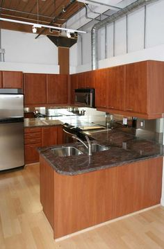 Marble Kitchen Counters, Kitchen Cabinets, Chocolate Company, City Restaurants, Wood Ceilings, Window Wall, Exposed Brick, Workout Rooms, Lofts