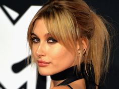 Hailey Baldwin's long, side-swept bangs are popular because they can be worn different ways.