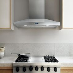 """With LUGANO, the beauty of stainless steel conveys understated elegance, with a gently tapered hood that measures only 5"""" high."""
