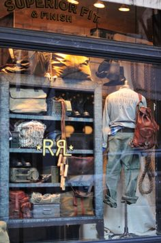 This window display puts the viewer right back to the time of WWII and the mannequin serves as a young man going off to basic training. RRL does a great job of capturing American history within their apparel and also through their store displays.