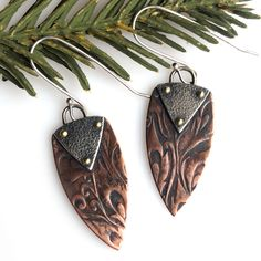 A nice fun pair of mixed metal spear earrings!