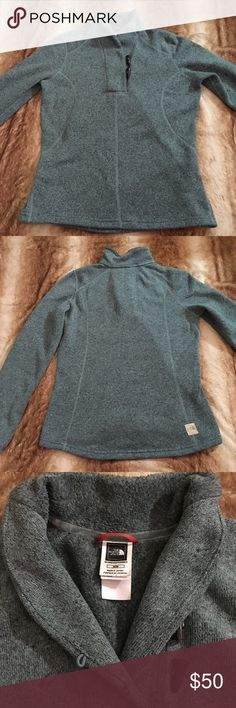 The North Face Sweater Warm North Face sweater in size M. Only worn once. Excellent condition. Button detailing on top. 100% thick polyester. The pictures are true to color. I would call it a blue/gray. The North Face Sweaters