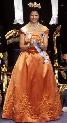 Queen Silvia of Sweden 1992 A coral-coloured evening gown of duchesse silk with appliqué and pearl inlays on the skirt. Designed by Jørgen Bender, Copenhagen. — Nobel gala gowns through the years 1976 - - Page 2 - the Fashion Spot