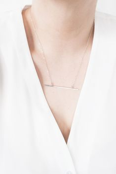A classic minimalist jewellery piece with clean lines and refined style. Shop: https://www.ohmyclumsyheart.com/products/sterling-silver-horizontal-bar-necklace