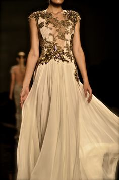 the embroidered top over plain bottom of this Reem Acra gown