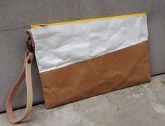 Kraft and Tyvek paper clutch bag yellow zipper with leather wristlet