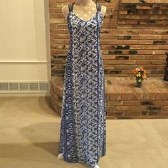 "Crisscross back maxi dress Classy sexy crisis cross straps and low dip back make this dress a stunner. NWT. Blue and white Ikat/tribal/boho/abstract pattern. Dress and full length lining 100% polyester. Measures 17"" from armpit across, 59"" long from shoulder to hemline. Hand wash. Made in China. Dresses Maxi"
