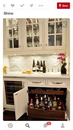 hidden liquor cabinet kitchen with backsplash bar cabinetry countertop kitchen remodel pinterest liquor cabinet kitchen and