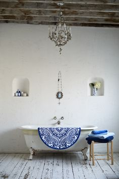 Lovely rustic bathroom with a pop of blue