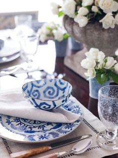 Bouquets of white roses paired with delicate blue china is the picture of unfussy elegance. See more from Aerin Lauder »   - Veranda.com