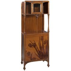 A French Art Nouveau marquetry cabinet by Louis Majorelle with depictions of iris flowers on the front panel. 1900
