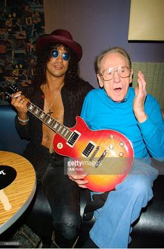 Slash and Les Paul during Gibson Guitars 50th Anniversary Celebration Honoring Les Paul at Iridium Jazz Club in New York, New York, United States.