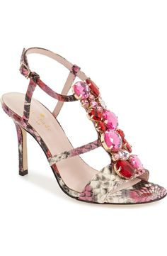 Multifaceted crystals cascade dramatically down the T-strap of this showstopping sandal by Kate Spade.