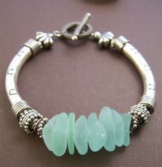 Mermaid Bracelet  Sea Glass with Sterling by StoneStreetStudio.  Reminds me of beach time in Calif. with the girls!
