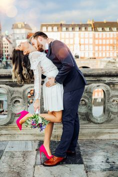 Wedding photo session at Stormbroen bridge in the centre of Copenhagen. The amazing style of the bride and groom made this picture even more stunning. I am in love with her Pink wedding shoes.
