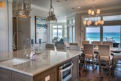 This kitchen features neutral quartzite countertop: Perla Venata Quartzite.