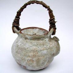 tea pot via brown dress with white dots