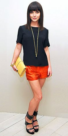 CHRISTINA RICCI  Proving that shorts aren't just for summer days at the beach, Christina selects a burnt orange pair with a black top, strappy wedges and a clutch for a Barneys New York celebration in N.Y.C.
