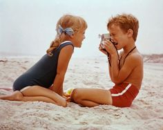Kids at the beach in the 60's