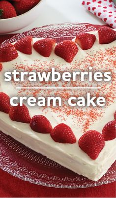 Make this Strawberries and Cream Cake for Valentine's Day! This heart-shaped strawberry cake topped with cream cheese and vanilla pudding frosting and fresh strawberries is a fresh and delicious indulgence.