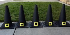 Orange safety cones sprayed to look like witch hats