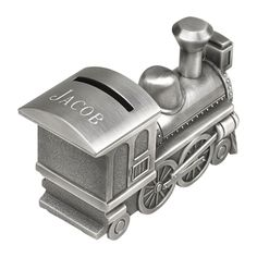 "All aboard! Our classic train engine is beautifully crafted and plated with our non-tarnish antique pewter finish. Produced with amazing, detailed artwork, there is room to personalize the item on the engine car rooftop measuring 1.25"" x 2"". Overall dimensions of the train bank are 6"" long x 3.25"" high x 2"" wide and the coin slot is located on the roof of the bank. Silver gift box."