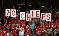 Kansas City Chiefs fans hold up the teams record following an NFL football game against the Houston Texans at Arrowhead Stadium in Kansas Ci...