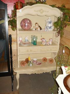 Its an upcycled French provincial hutch top with a French provincial coffee table for the bottom.  I attached them together for a one of a kind display shelf.