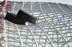 hockey pucks and net