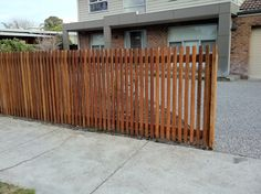 Narrow timber battens as fencing idea.