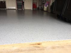 Garage floor with an epoxy partial flake. Customer had VCT and had a water leak which damaged the tile. They wanted a flooring that could withstand another water leak if it happened. They couldn't be happier.