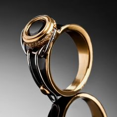 "Engagement Ring of Coral Cohen  Photo by Yoav Reinshtein  ""Cork ring""yellow gold 22ct,diamonds,black diamond,stainless steel,enamel.  by Gregory Larin"