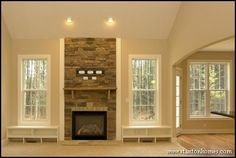 Fireplace with windows on either side would really open up the room.