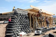 Global Model 2bed Earthship Images. Using tires with packed dirt inside for the construction of some of the walls.