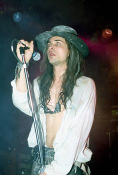 Singer Carl McCoy of the gothic rock band 'Fields of Nephilim' performs onstage in circa 1988
