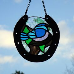Stained Glass Blue Bird Suncatcher in Horseshoe. Hand crafted by Janice Finn Culp.