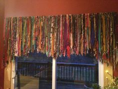 80 inches wide. Strands from 18-36 inches long. Grey background NOT included. Looks as if its layered! Ripped pieces of fabric. Brightens yet relaxes any room. Any width and length can be custom made. Please convo any questions or custom design request! Please send in your city, state and zip if you are wanting to purchase. I do ship out of the United States with shipping price adjustment.