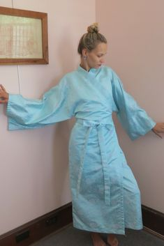 7d99867f3d13 Beautiful light blue vintage kimono with pink embellishments.