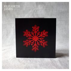 Red with black Christmas card Red with black Fine Art Photography Art Card  A simple yet stunningly pretty red snowflake against a black background. All good things come in small packages they say!  Limited edition of 250  Blank inside for your own message with white envelope  individually wrapped in cello bags  Signed and numbered  Made in Britain  12x12cm  helps to fund the fantastic efforts of the woodland trust in protecting and creating our beautiful native woodlands. 330 micron Trucard