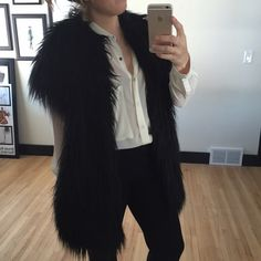 """Rachel Zoe Faux Fur Black Shag Short Sleeve Vest Vintage-inspired shag adds instant edge for high-drama style. Vintage-inspired faux fur shag. Open front. Short sleeves. About 28"""" from shoulder to hem. Acrylic. Fully lined. Spot clean. Imported. US size 4. Rachel Zoe Jackets & Coats Vests"""