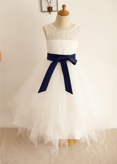 The dress is made of high quality of lace and tulle fabric.The listed color is ivory with navy blue sash.Just love the uneven look skirt in knee length.It has keyhole back.Perfect for wedding,birthday,holiday or everyday wear.For Custom Dress, please enter the measurements at Custom Note Box which y