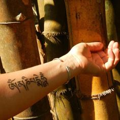 Om Mani Padme Hum (Mantra of Compassion) in Tibetan tattoo
