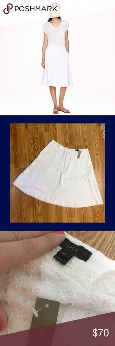 J Crew Eyelet Midi Skirt NWT Brand new with tags eyelet midi skirt by J Crew. This gorgeous and versatile skirt can easily be dressed up or down and can be worn in many different ways. Size 14. I accept offers but please NO trades! J. Crew Skirts Midi